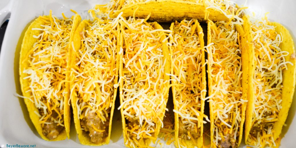 Shredded cheese topped ground beef baked tacos