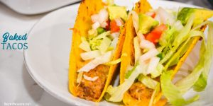 Creamy ground beef baked tacos are made with corn or flour shells, ground beef, taco seasoning, cream cheese, and salsa before topping with shredded cheese.