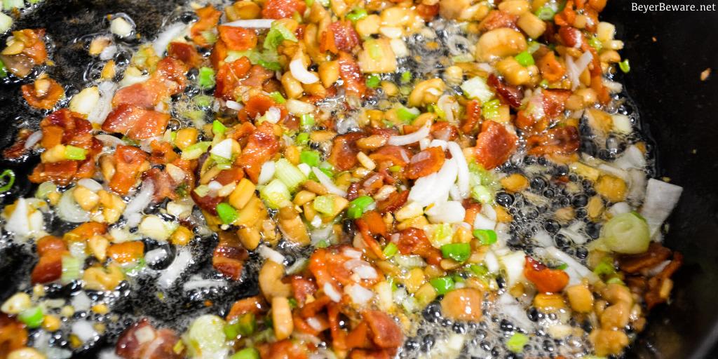 Frying bacon, mushrooms, onions, and garlic