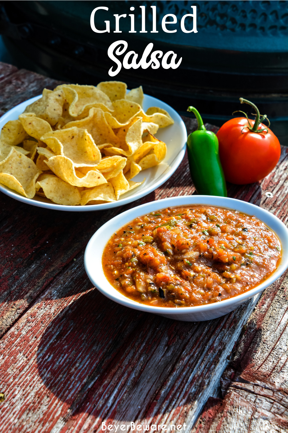Fire-roasted salsa recipe takes garden fresh tomatoes, jalapenos, onions, garlic, and cilantro to the grill for a flame-grilled salsa recipe that is outrageously good and easy to make.