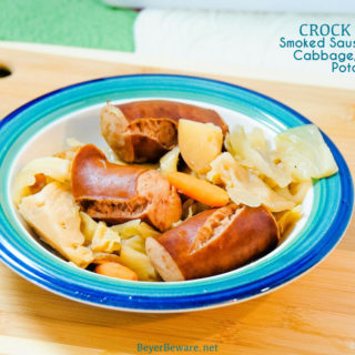 Crock Pot smoked sausage, cabbage, and potatoes is an easy dinner idea using garden fresh vegetables like cabbage, potatoes, onions, and carrots that have been slow cooked in the juices from the smoked sausage.