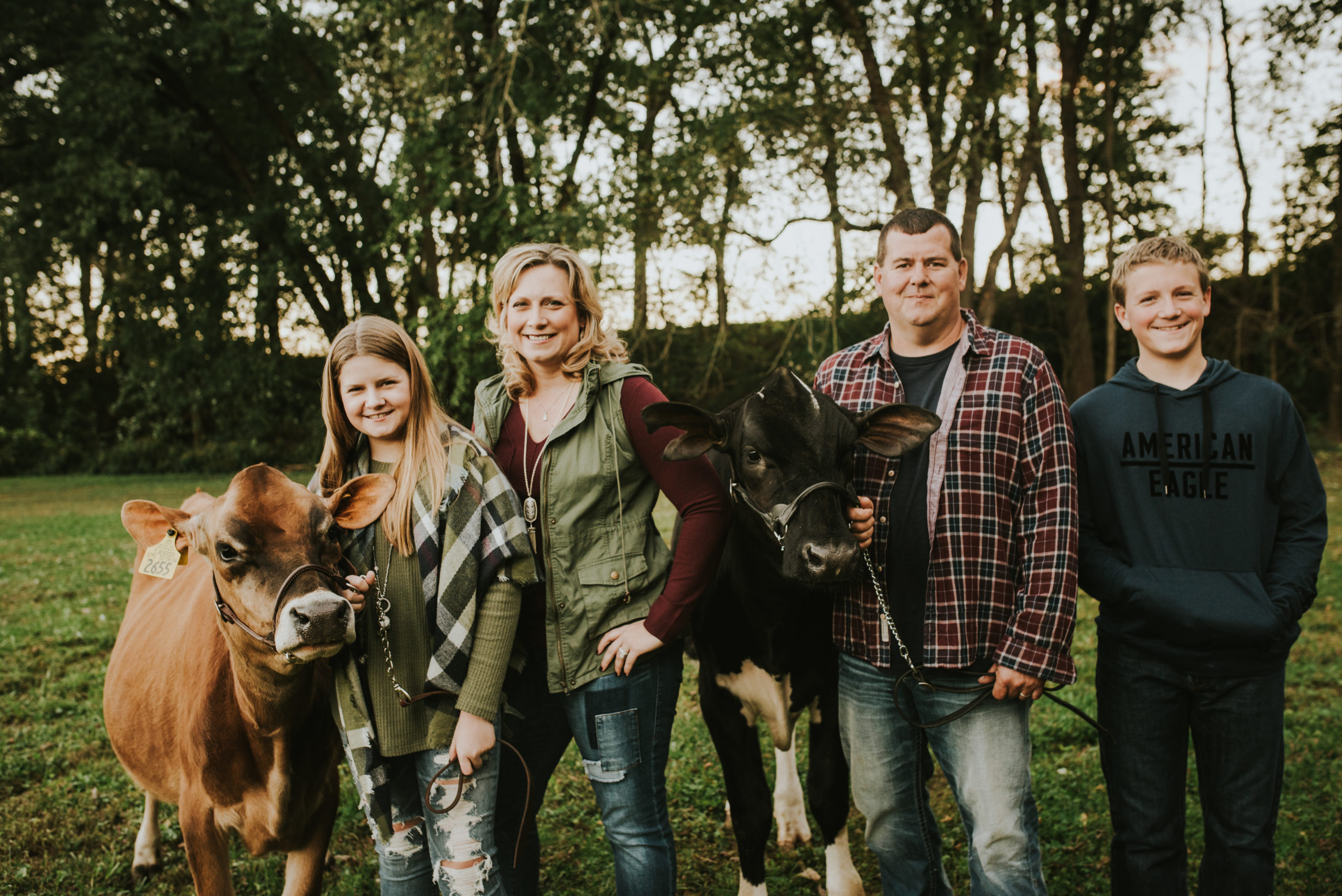 Beyer Family photo with Jersey and holstein calves