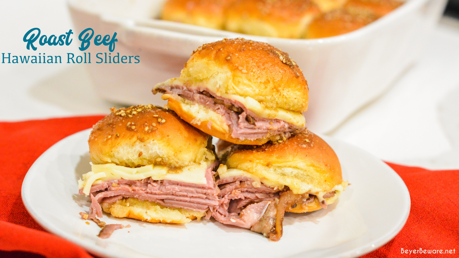 Roast beef Hawaiian roll sliders, or more affectionately called Sandy's Sandwiches, combine butter, garlic powder, worcestershire sauce, and poppy seeds for a butter glaze that compliments these baked roast beef and cheese sandwiches.