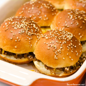 Hawaiian roll hamburger sliders recipe is a loose meat cheeseburger sliders pan fried with onion soup mix and mayonnaise then baked on the butter topped rolls with lots of cheese.