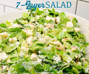 Overnight lettuce salad is my grandmother's version of 7 layer salad made with lettuce, cauliflower, mayonnaise, onions, celery, bacon, and parmesan cheese.