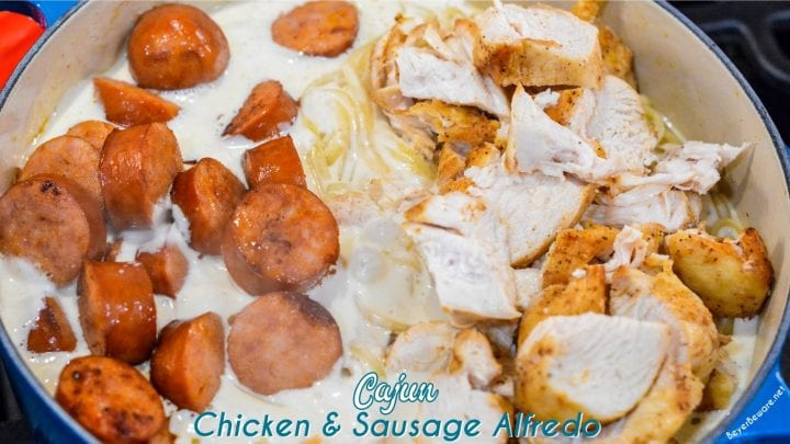 Cajun smoked sausage and chicken alfredo combines air fryer grilled chicken with pan sauteed in a skillet with garlic before being combined with alfredo and a creamy parmesan alfredo sauce.