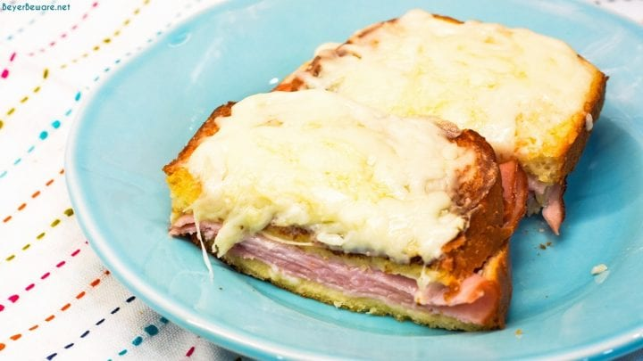 Croque Monsieur is an over the top grilled ham and cheese sandwich recipe that is made with King's Hawaiian bread, Smithfield smoked ham, swiss and gruyere cheese, and a mustard Bechamel sauce.