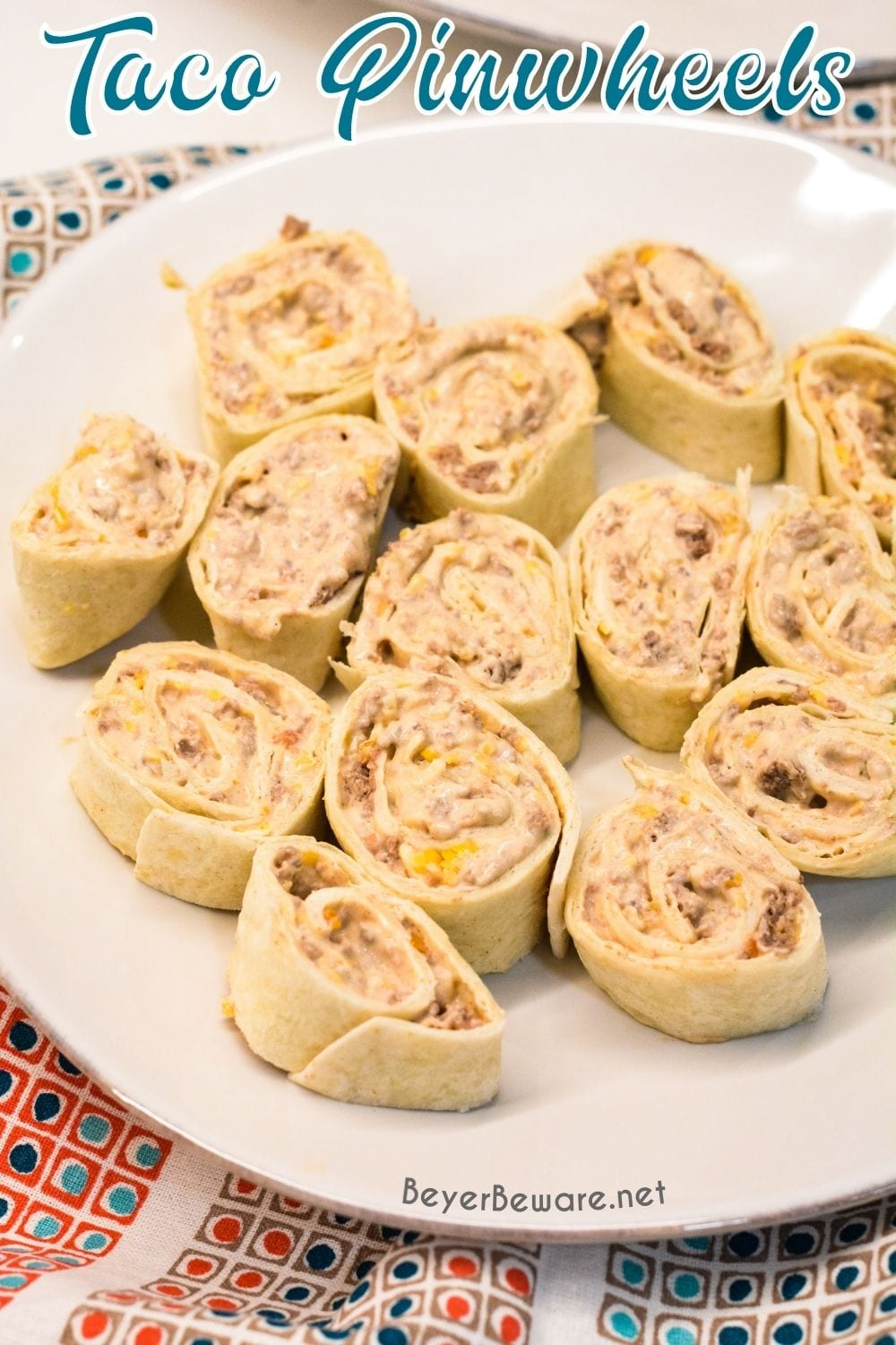 Taco pinwheels are the perfect way to use up leftover taco meat and tortilla shells in a different way than just as tacos again by simply mixing cream cheese, salsa, and taco meat together and spreading over the tortilla shell before rolling up into a pinwheel.