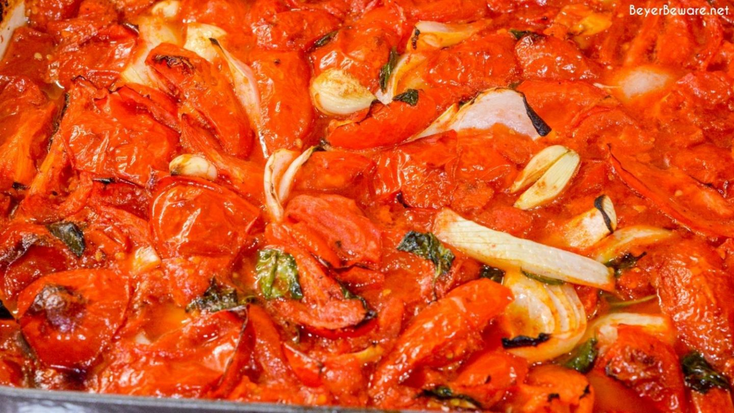 Tomato basil sauce is easy to make by oven roasting the tomatoes, garlic, onions, basil, and olive oil before pureeing into the sauce.